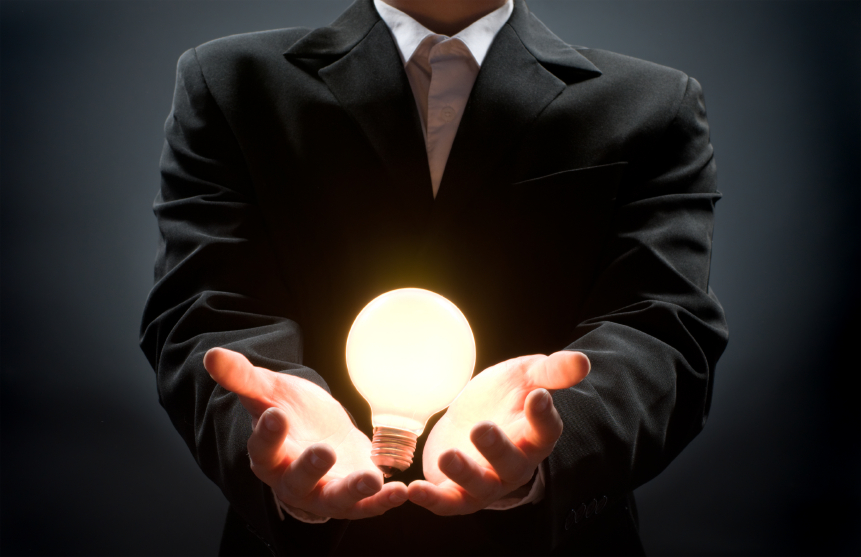 a man pointing to the illuminated bulb